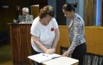 Representando o Cofen, a enfermeira Ivone Martini assina a posse